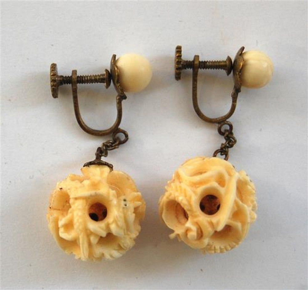 A Pair Of Carved Ivory Puzzle Ball Earrings Suspended On A Necklace Chain Jewellery