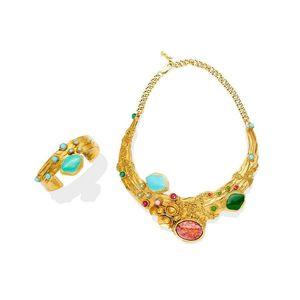 4b0c013cec6 A gilt metal and enamel suite, Yves Saint Laurent. Comprising collar and  cuff, t he textured collar set throughout with blue, green, pink and coral  toned ...