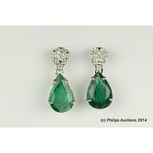 623bda113 A pair of emerald and diamond earrings. 18ct white gold, crafted as short  articulated drops, each featuring a pear cut emerald of strong medium  green, ...