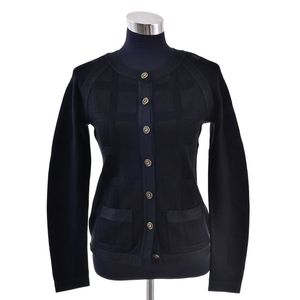 f6fde8940567 A Cardigan by Chanel, styled in black silk blend with bronze metal button  detail, size FR36