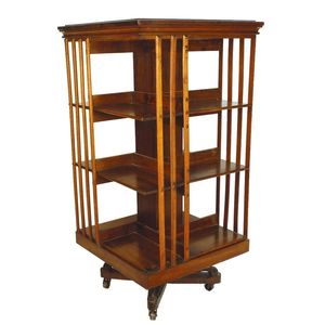 A C1900 American Danners Revolving Bookcase In Mahogany Of Three Tiers With Triple Slatted Sides On Sturdy Cast Iron Mounted Four Way Base