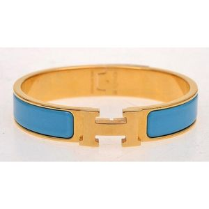73e466ffadc70b An enamel Clic H bracelet by Hermes, styled with blue enamel in a gold  plated band; boxed.
