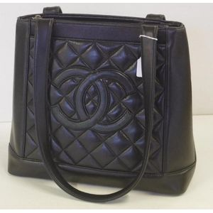 Chanel style black leather handbag one side with Chanel insignia,reverse  side quilted, interior zip up compartments. Show 48 more like this 38d70333df