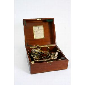 A Hermes leather bound travelling backgammon set includes two