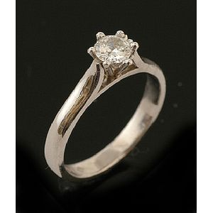 52b08bca5 A diamond solitaire ring, the round brilliant cut diamond weighing 0.34cts  in six claw platinum setting signed Michael Wilson Show 9 more like this