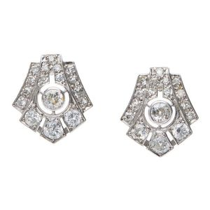 c6ed3f28b A pair of Art Deco diamond earrings, each geometric pierced plaque, set  with old European and single cut diamonds, in platinum.