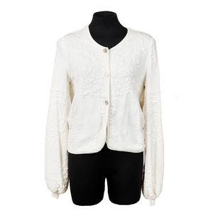 7f0075ef7210 Chanel, jacquard cardigan, white cotton blend in woven pattern, ribbed  cuffs and balloon sleeves, signature 'CC' button down closure, labelled ' Chanel, ...