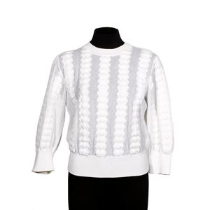 26fa5818fa5c Chanel, Bobble sweater and skirt, semi-sheer white with long sleeves, round  neck, panelled detailing and rib hem, the skirt of similar composition with  ...