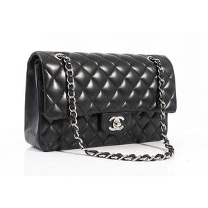9a6717ebf70d A medium classic flap bag by Chanel, styled in black quilted lambskin  leather with silver metal hardware and woven chain metal long strap,1  0662167, ...