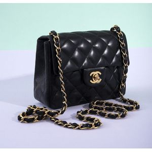 4067580bb561f A Mini classic flap handbag by Chanel, styled in black leather with gold  metal hardware and gold leather chain strap, 13 x 17 x 6.5. Show 8 more  like this