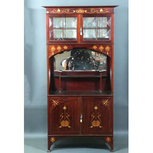 An Art Nouveau Mahogany China Cabinet, The Frieze Inlaid With Lotus  Flowers, The Lower Section With Mirror And A Pair Of Panelled Doors, 177 Cm  High, ...