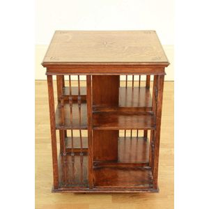 An Edwardian Oak Revolving Bookcase Circa 1900 The Square Bull Nosed Edge Top With Inlaid Central And Corner Decoration Stringing Over A Four