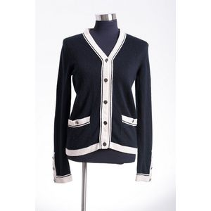 8112915c4ec0 A Cardigan by Chanel, styled in navy cashmere with creme trim and  embellished buttons, size FR36