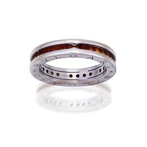 96c9bf75c856c 18ct white gold and citrine 'B.zero1' ring, Bulgari, Centring a continuous  line of carre-cut citrines between a raised edge, the sides engraved BVLGARI  ...