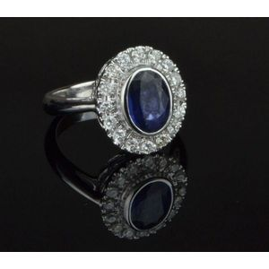 8c7c97e62 Sapphire and diamond dress ring 9x6mm oval sapphire embellished with 16  round brilliant cut diamonds = 0.40cts colour G-I, clarity SI 18ct white  gold with ...