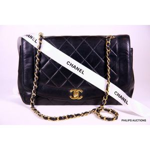 49c63437a68c A black Chanel handbag, black leather lambskin, presented as classic  quilted fold over handbag with turn key Chanel motif closure, completed  with gold ...