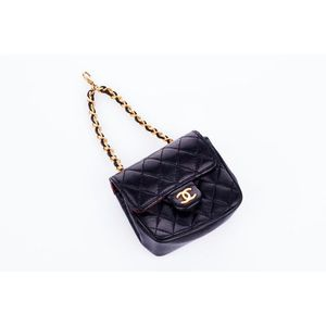 67466880ad1b Chanel, Mini 2.55 flap bag charm, black quilted lambskin, gold tone  hardware with single leather and chainlink strap, exterior slip pocket,  button closure, ...