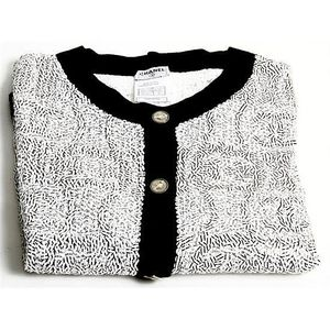 af3960f654b5 Chanel 100% cashmere sequined cardigan in black and white. Size 42.  Accompanied by Chanel plastic protective bag.