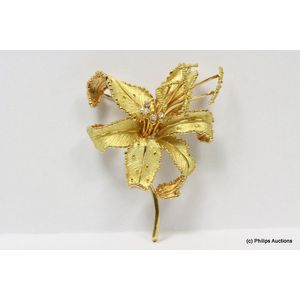 eddf38ab1 A diamond set gold flower brooch, 18ct yellow gold, made as a large,  naturalistically set floral spray brooch, designed as a series of etched  unfurled ...