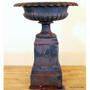 A Large Cast Iron Garden Urn And Plinth A Lobed Urn With A