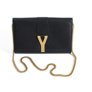 a889592a6d9 A Ligne bag by Yves Saint Laurent, styled in black leather with gold metal  Y clasp and chain strap, 14 x 22 x 3 cm, boxed