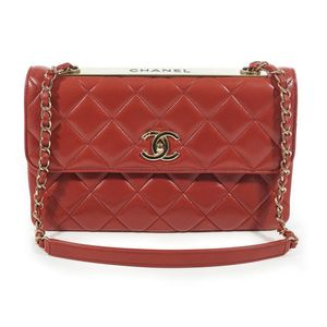 bc6e5562ee43db A Trendy medium flap bag by Chanel, styled in red ochre lambskin quilted  leather, with gold metal hardware and chain weave strap, 26.5 x 17 cm, boxed