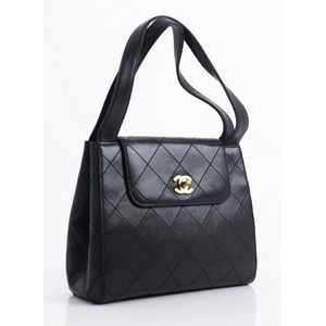e9f5ca06a7c0 A tote bag by Chanel, styled in black leather with gold metal hardware, 20  x 23 x 8 cm. Show 8 more like this