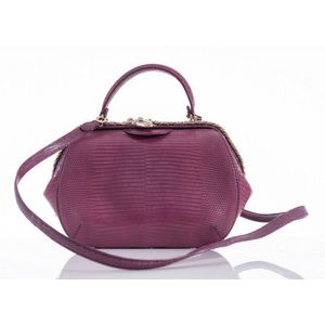 ed8558f30223 A Serpenti Hypnotic top handle small bag by Bvlgari, styled in magenta lizard  skin with gold metal and enamel clasp, with detachable long strap, ...
