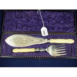 Antique bone handle fish servers in case