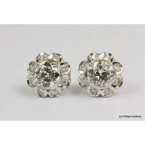 b50d581fc A pair of diamond cluster stud earrings, 18ct white gold, made as floral  style cluster studs, each set with a central brilliant cut diamond of  approximately ...