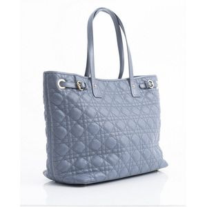 35025e78a A tote bag by Christian Dior, styled in light indigo coated Cannage canvas  with gold metal hardware, 28 x 34 x17 cm
