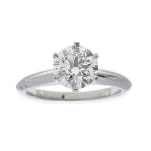 76635e91b A solitaire diamond ring by Tiffany & Co, the round brilliant cut diamond  weighing 1.70ct, in a six claw setting, in platinum, accompanied by a  Tiffany & Co ...