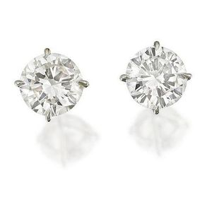 91037e5c9 Pair of diamond studs, the round brilliant-cut diamonds each weighing 1.28  and 1.20 carats are claw-set and mounted in 18ct white gold.