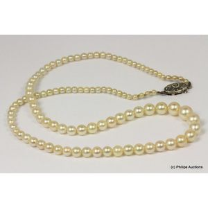 c29b0b28b6166c A simple strand of vintage cultured pearls, sterling silver set, presented  as a single short strand of graduated round cultured pearls, ranging in  size from ...