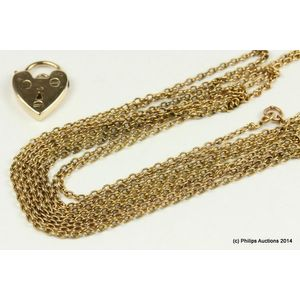 3a38bff8454 An antique gold muff chain and padlock