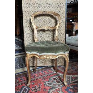 352a11550c96 A gilt-wood salon chair with a gilt-wood oval cane side table