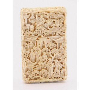 4c3dd6d5794906 A carved Chinese ivory card case decorated with a village scene. Length 9 cm