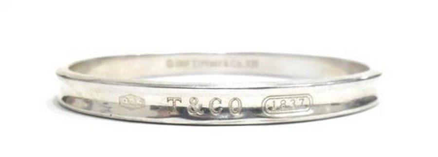4e333a151 A sterling silver '1837' bangle by Tiffany & Co, oval concaved ...