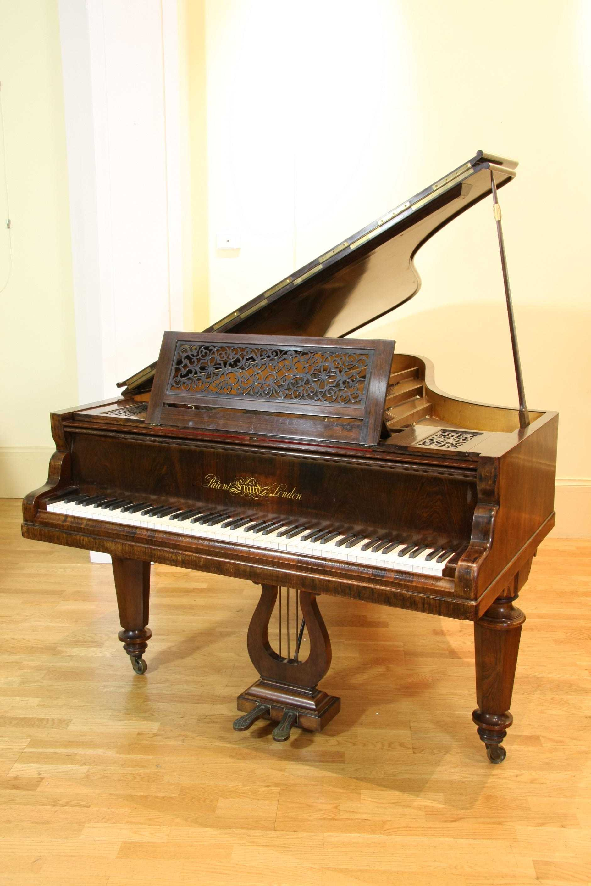 Erard baby grand piano with a rosewood case and a fretwork ...