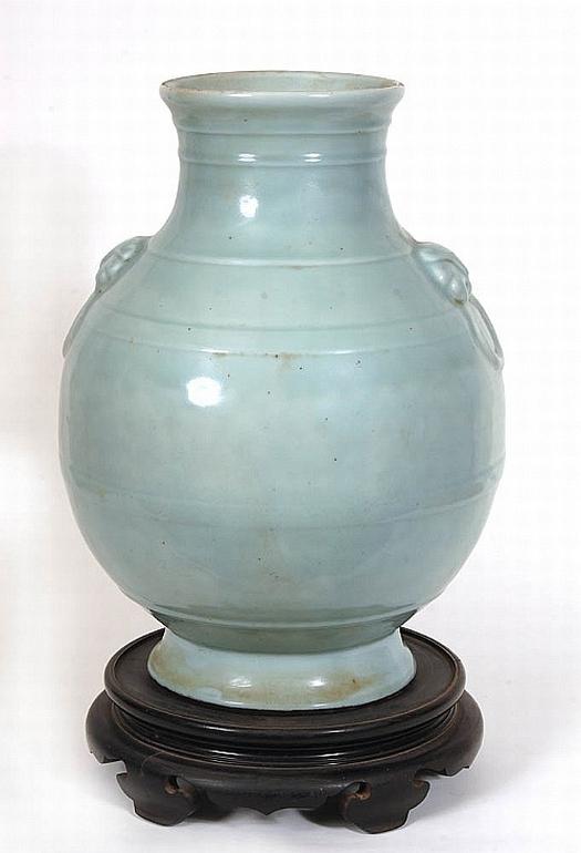 A very large Japanese celadon glazed vase on hardwood ...