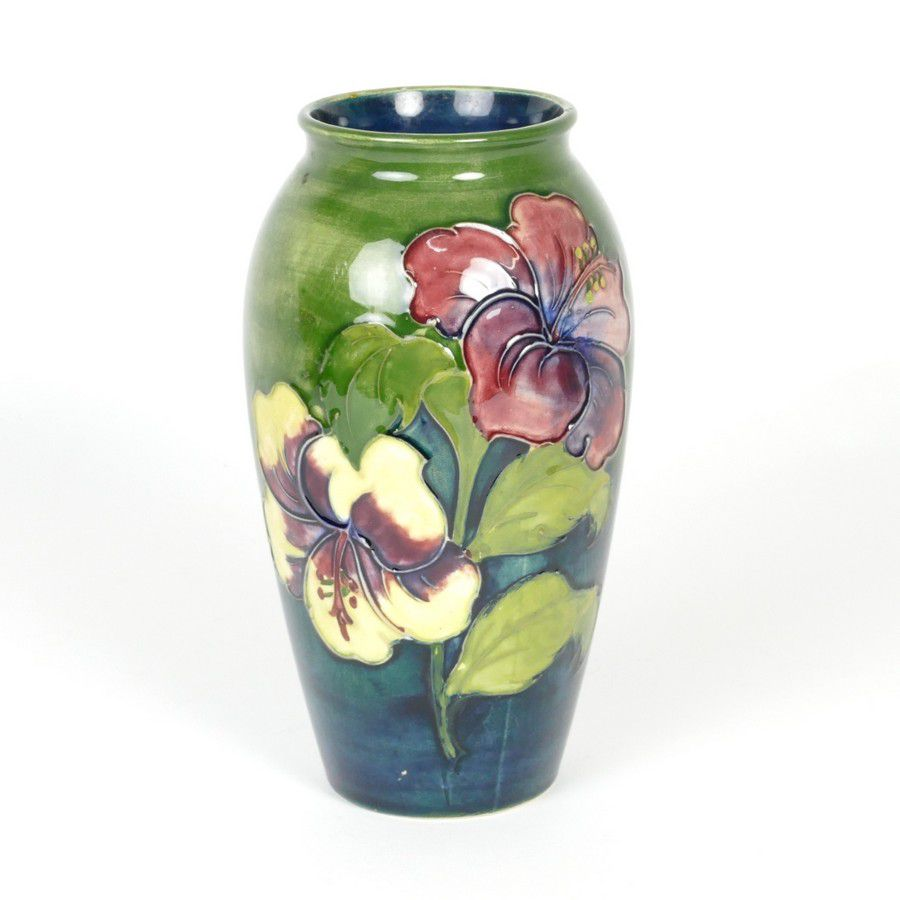 A Walter Moorcroft 'Hibiscus' pattern baluster vase, on a