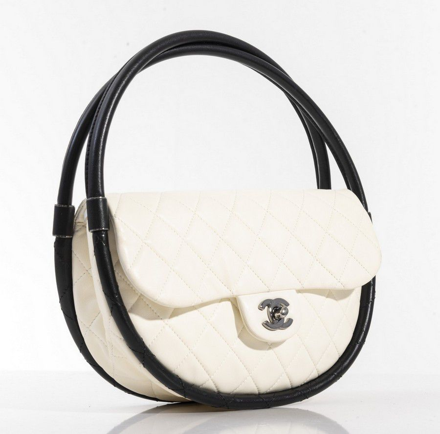 e7d95b6708dc A small Hula hoop bag by Chanel, styled in white quilted… - Handbags ...