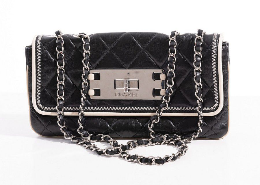 76d951ad0b32 An East West Mademoiselle flap bag by Chanel, styled in black ...