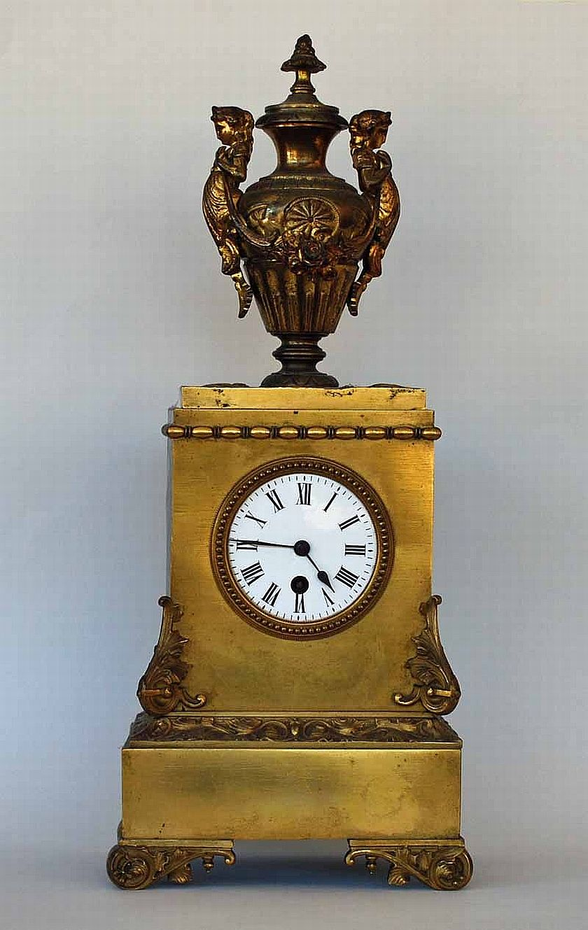 A gilt bronze French mantle clock with key. (working at
