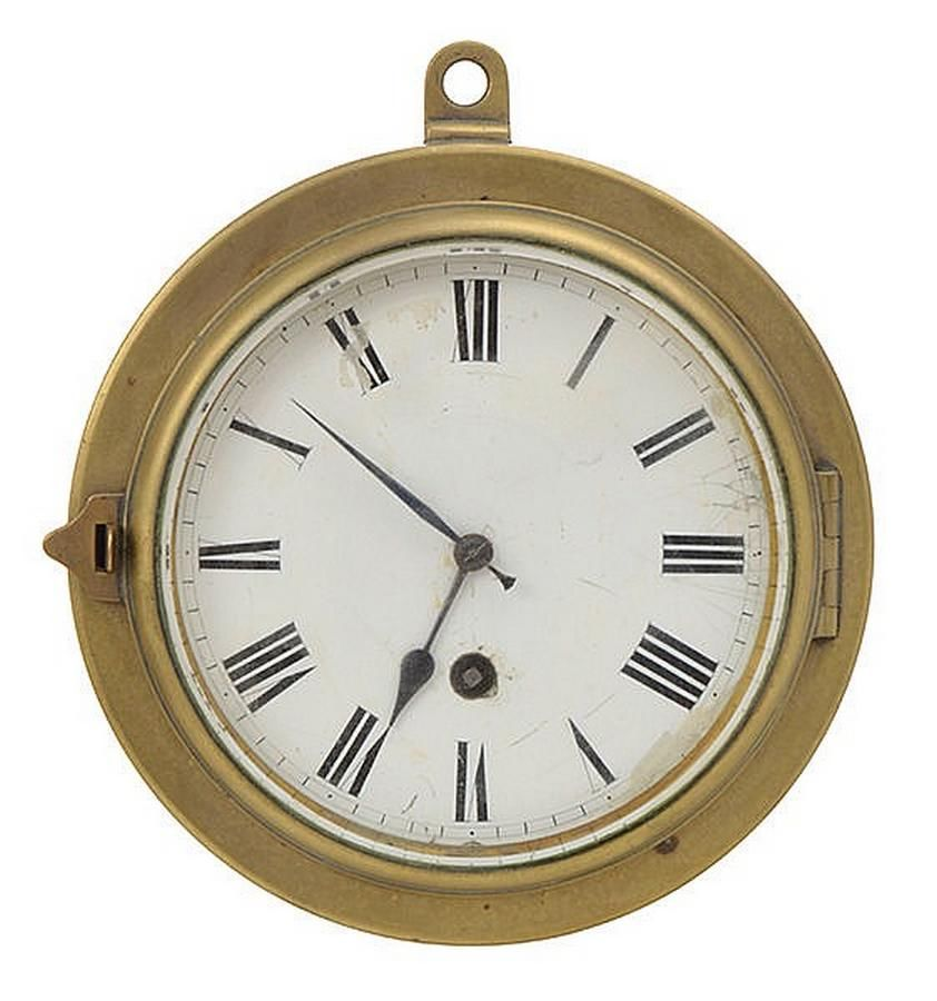 A Brass Cased Ships Clock With An Enamelled Roman Numeral