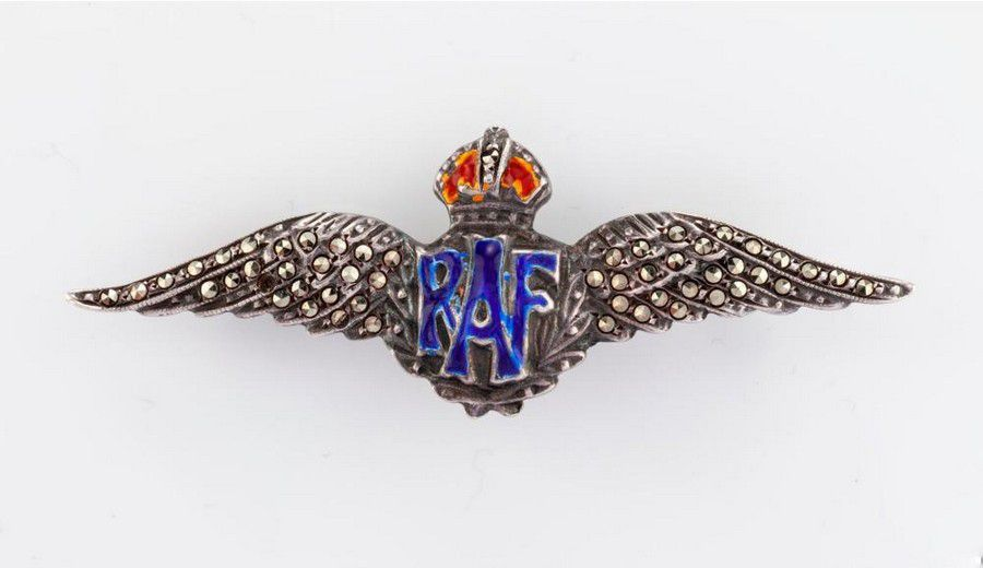 An enamel and marcasite 'RAF' brooch the winged brooch set