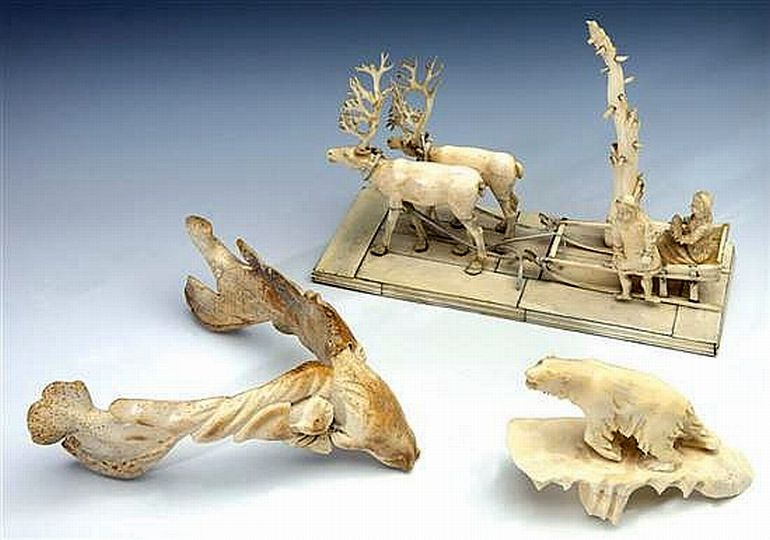 A Chukchi Carved Ivory Scene A Carved Jaw Bone And A Zother Sculpture Statuary