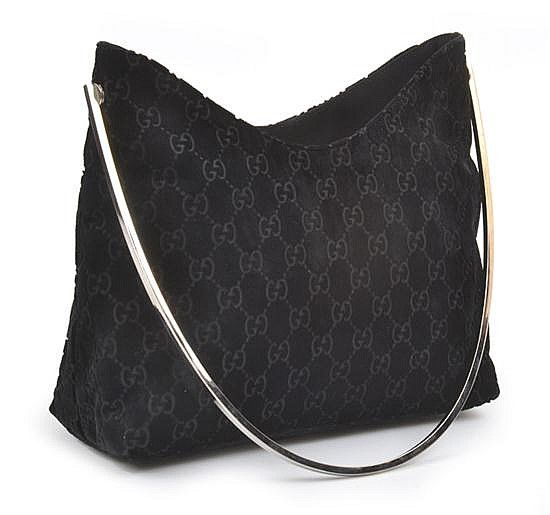 1a2226e1fa8120 An evening bag by Gucci of monogram design, styled in black ...