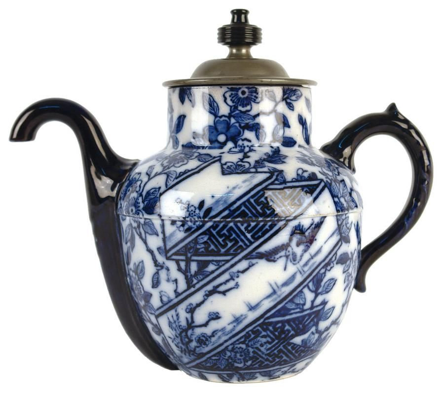 A Royales Patent Self Pouring Teapot Manufactured By