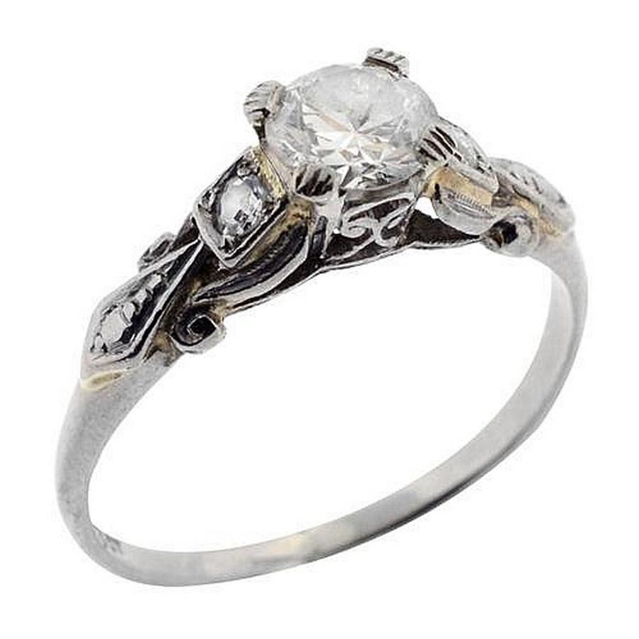a vintage 18ct gold ring platinum set with a
